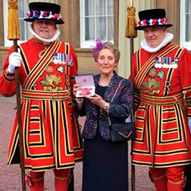 Margaret Frogson looking elegant in her David Nieper jacket while receiving her MBE in the Queen's 90th Birthday honours list